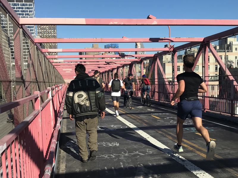 Photo of the Williamsburg Bridge's side by side bike and pedestrian spaces